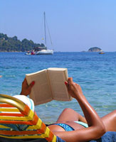 Left the boat on anchor and catched a sun bed to relax - Skiathos Island